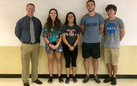 Principal Nathan Hostetler stands with four seniors who were named National Merit Semifinalists. [From left to right] Seniors Madeline DeGraw, Arianna Chaves, Blake Peters and Riley Lawson were all named National Merit Semifinalists.