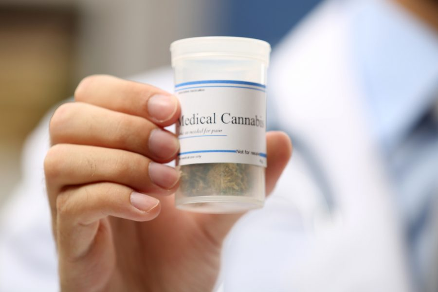 Doctor hand holding bottle with medical cannabis close up (Image from Shutterfly)