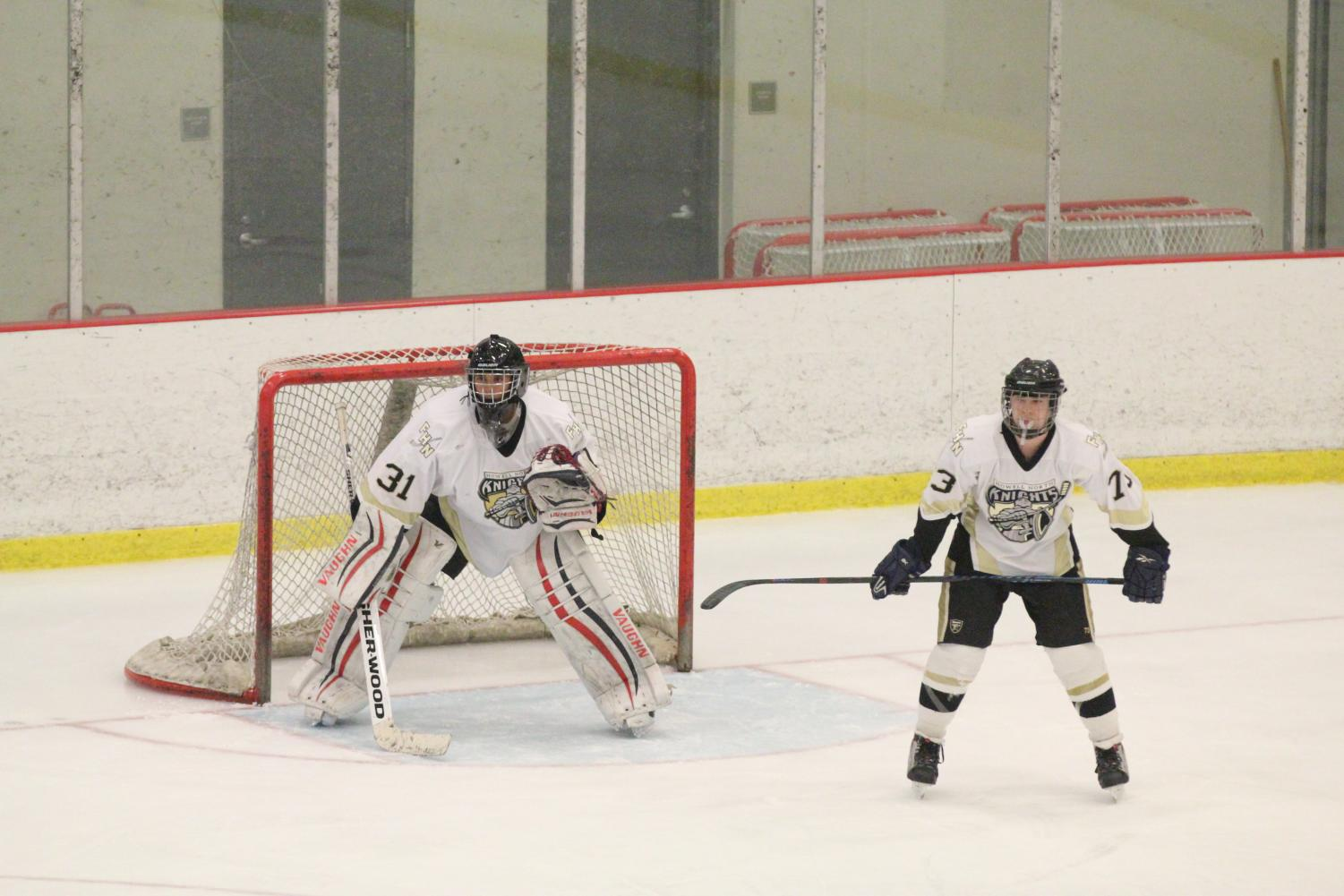Senior Drake Johnston and junior goalie Charlie Jones guard the goal in a match against Fort Zumwalt South