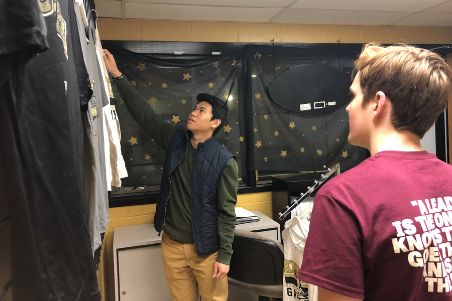 StuCo Vice President Juan Alega and StuCo Brendan Gannon discuss items in the new StuCo sponsored spirit store, The Armory. This store will open on Jan. 29, after almost a year of planning.