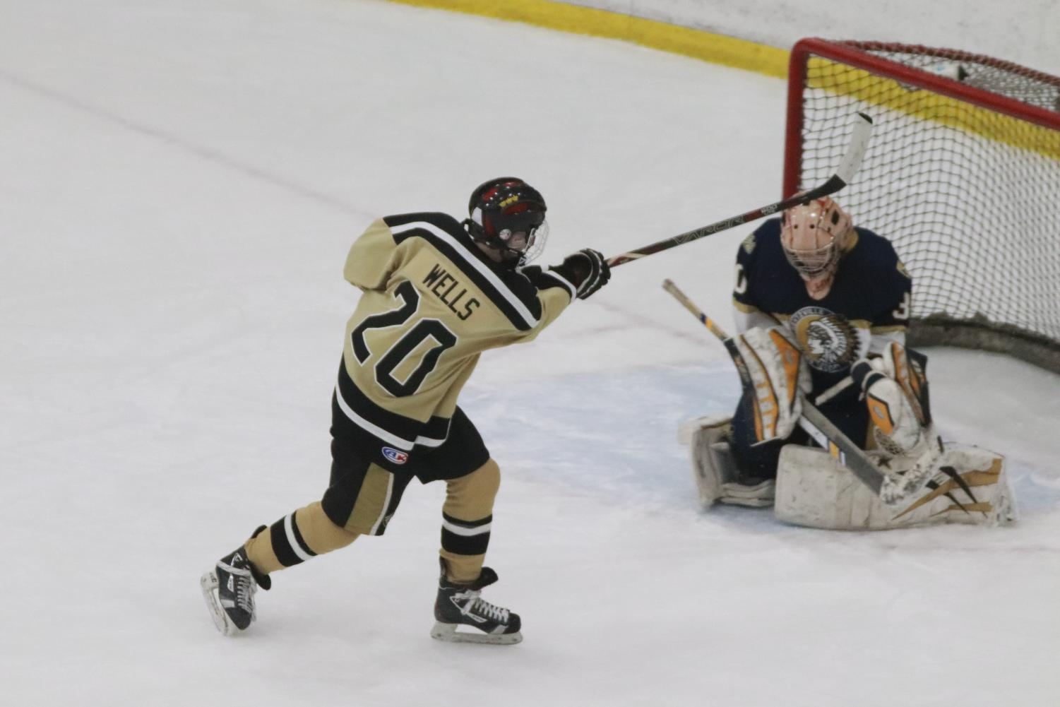 Freshman Matt Wells attempts to score a goal during their game against Holt.