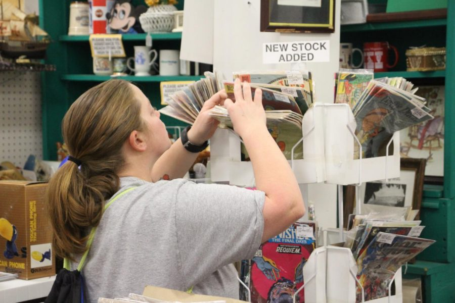 A customer goes through old record albums at the Antique Mall on Dec. 1. The mall has many different displays showcased throughout the store, with a variety of vintage items.