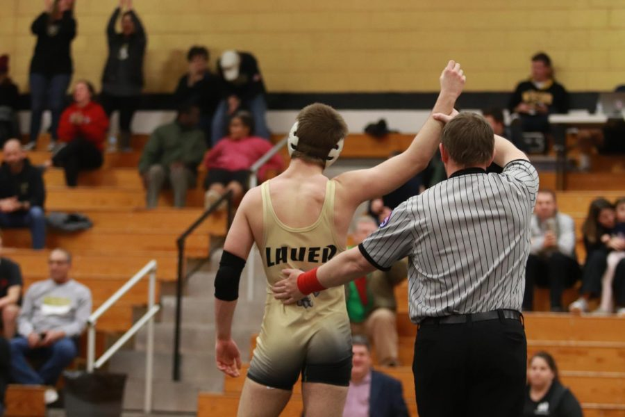 Senior Dillon Lauer gets declared the winner of his match during the duel vs. Howell