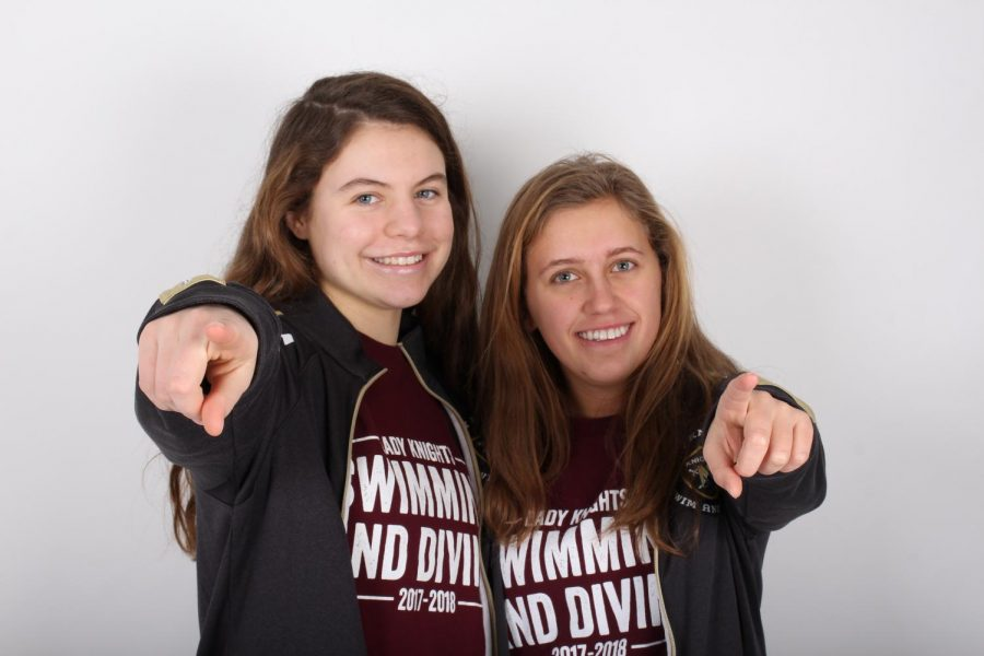 Swim team captains sophomore Olivia Neunaber and senior Hannah Miller stand together and show leadership and sportsmanship. Neunaber and Miller were chosen by the team to be captains for the 2018 winter season. As captains, they will communicate with coaches, lead practices and more.