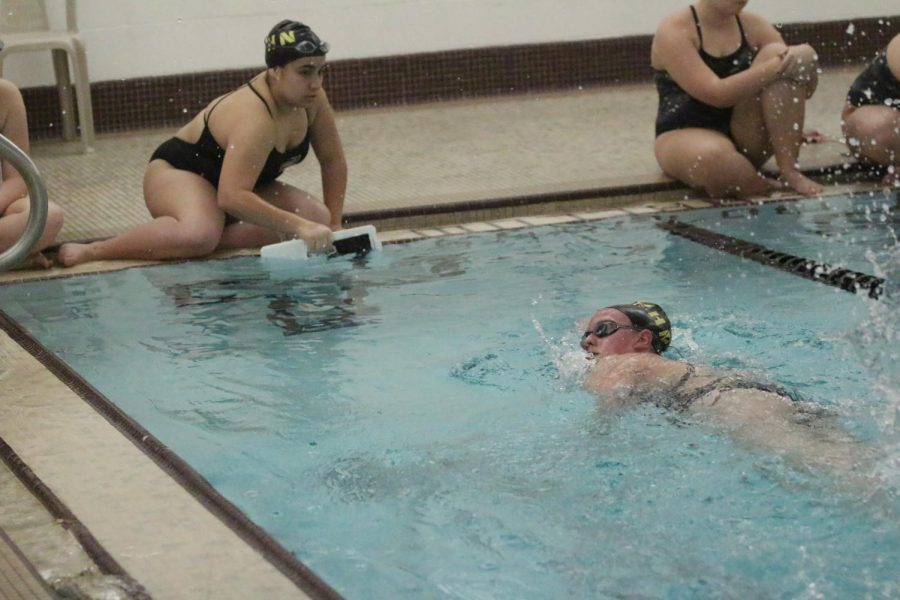 Freshman Ana Sofia cheers on fellow teammate Grace Bigogno as she completes her 500 yard event on Jan. 9.