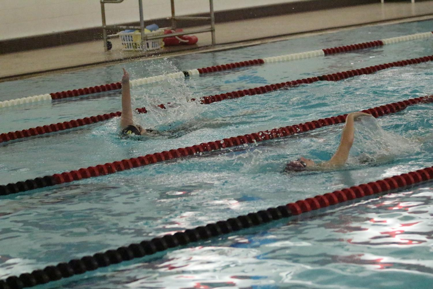 FHN swimmer competes in the backstroke.