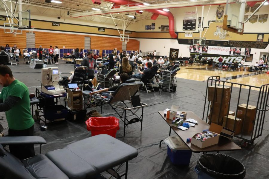 Students scatter at different stations all over the FHN Gym for the blood drive. The stations are placed in an order to ensure that students are able to safely donate blood. The blood drive was open for students and teachers from 8:00 a.m. to 1:00 p.m.