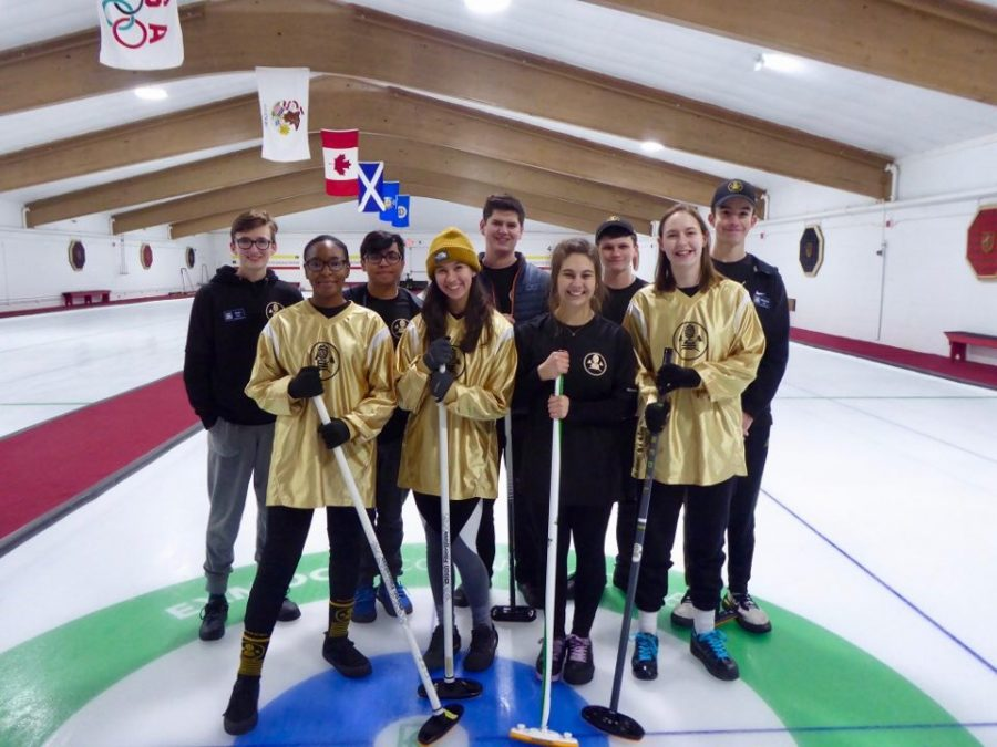 The curling team poses for a picture in Exmoor Country Club in Chicago during their trip in late December. The curling team has existed for two ears and placed third in lat year's regional tournament.