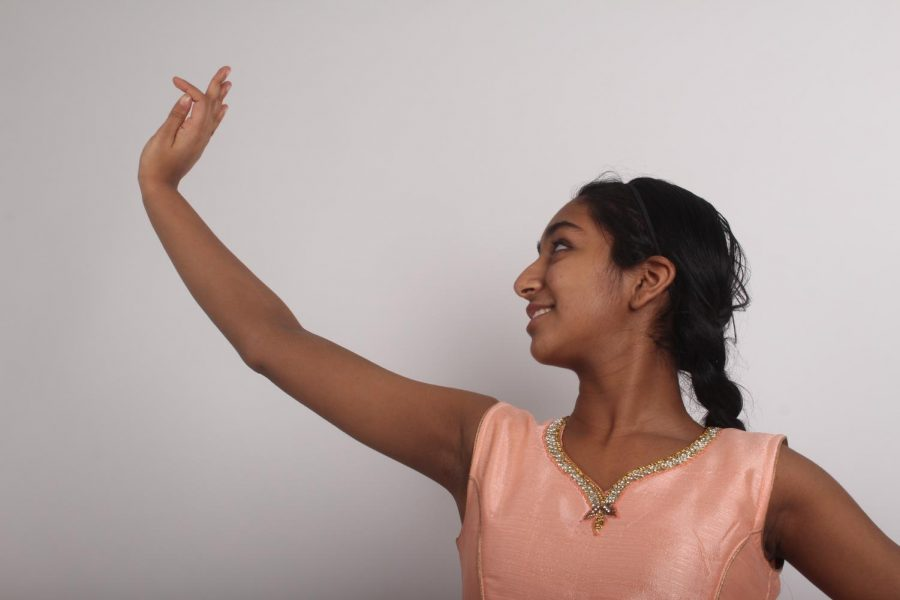 "Freshman Amoolya Pandurangi poses for a picture while showing off some of her dance positions. Pandurangi has been dancing for five years and plans on continuing dance in her future. ""My favorite thing about dancing is the footwork. In kathak footwork is one of the highlights of it and it just brings me joy,"" says Pandurangi"
