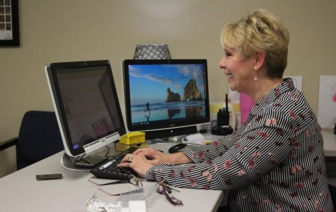Ree Ann Noah poses for her a picture at her computer. Noah is Support Staff Member of the Year. She is Dr. Nathan Hostetler's secretary and deals with making appointments, organizing substitute teachers and overseeing Hostetler's schedule.