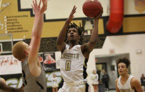 Senior Miles Montgomery drives to the basket to make a layup.