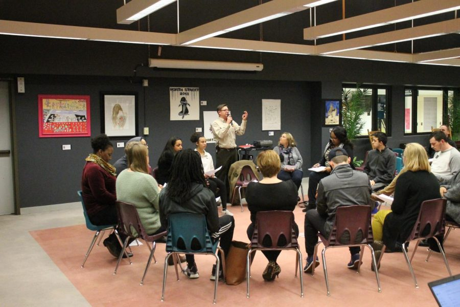 Students+and+community+members+sit+and+listen+as+principal+Birch+introduces+the+night.+Students+went+in+a+circle+answering+questions+about+their+social+upbringing%2C+and+community+involvement.