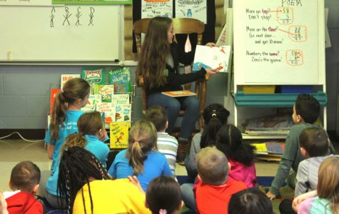 NHS Celebrates National Read Across America Day by Reading to Kids at Henderson Elementary