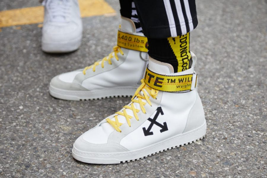 MILAN - JANUARY 15: Man with Off White sneakers with yellow belt before Represent fashion show, Milan Fashion Week street style on January 15, 2018 in Milan. - Image