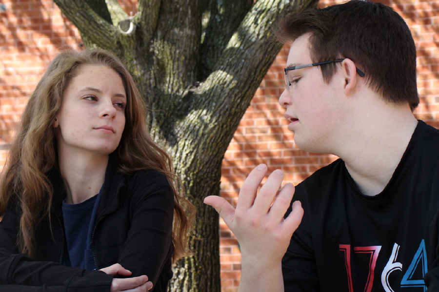 Friends, sophomore Allie Moore and junior Bret Hammond, sit and chat in the courtyard. The pair have been friends for over a year and have formed a very strong, unique bond. They frequently go out to sporting events together and participate in many fundraising events for Down Syndrome.