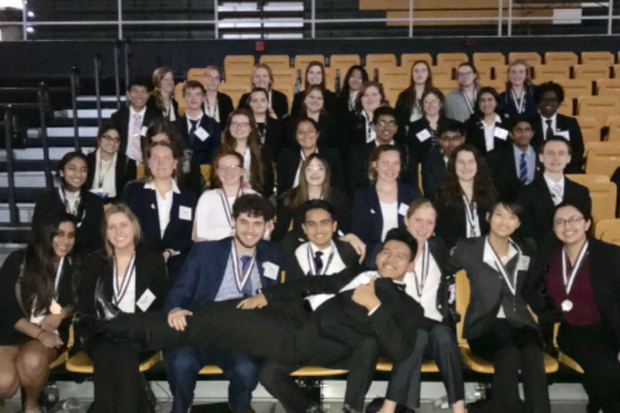HOSA poses in front of the camera for a photo after their competition. HOSA is a club consisting of those interested in pursuing a future career in the medical field. 18 members were able to achieved top three for their event.