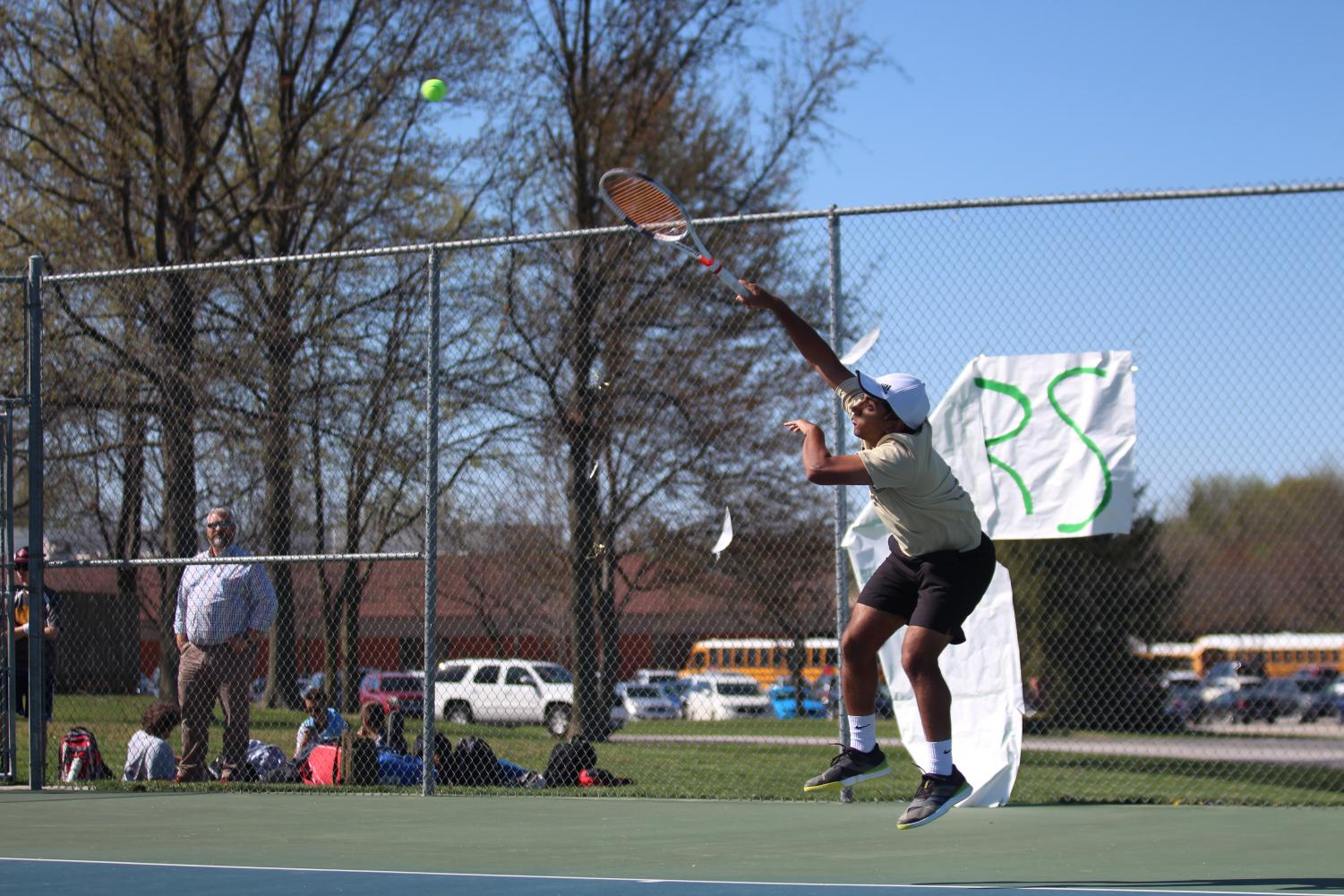 Sachin Milli unloads on the ball after his serve.