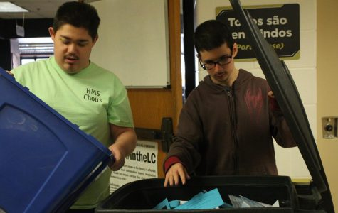 Juniors Austin Marquart and Derek Oughton Pick Up Recycling Around the Building