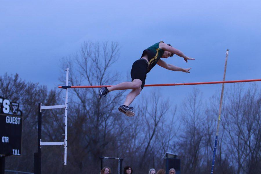 FHN+pole+vaulter+leaps+over+the+bar+in+a+competition.