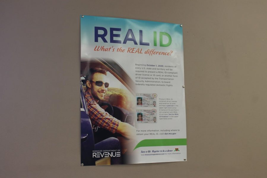 A poster hangs on the wall in the DMV to show that Missouri is making new ID's. Missouri's old ID's have been around since 2005 and older. The change finally happened in March when they decided to go with the REAL ID idea from the Federal Government.