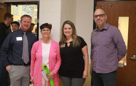 [From left to right] Head Principal Nathan Hostetler poses with Howell of Fame Inductee Donna Malkmus. Two District representatives, Deanna Kruse and Adam Corbitt, presented Malkmus with the honor.