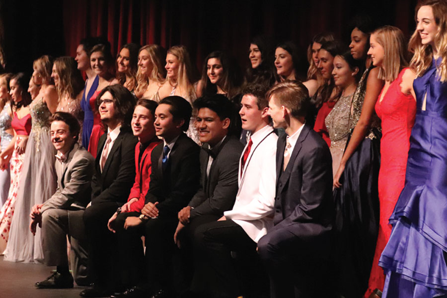 FHN students pose together and model the prom fashion trends for the year. The fashion show was hosted by the Junior Delegates to raise money for prom. The event is a chance for students to model dresses and suits from area stores.