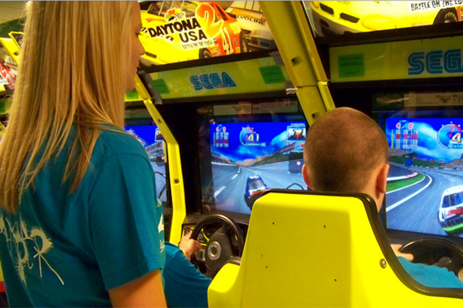 Seniors play arcade games at the annual All-Knighter senior parents put on for the graduating class.