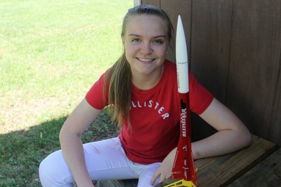 Sophomore Amber Sheulen poses with a small model of a rocket. Sheulen is in a program called CAP which is basic training for the Air Force. In CAP, they do many things such as working out, learning to fly and flying planes, even looking at some rocket science.
