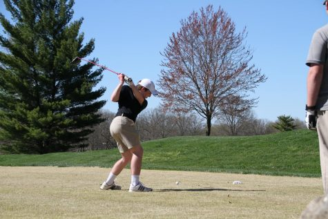 Freshman Joey Key swings his club in a round of golf.