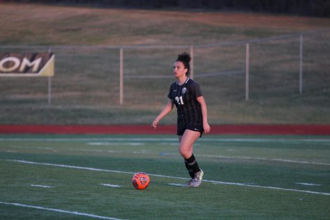 Freshman Makenna Davis dribbles up the field during a game. Davis, along with Jessica Gillen, have been starters on the varsity team since the beginning of the year.