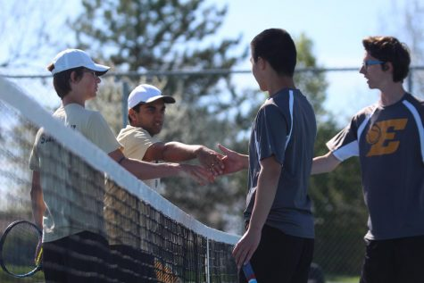 Senior Sachin Milli and junior Will Schellman shake hands with their opponents  after a match.