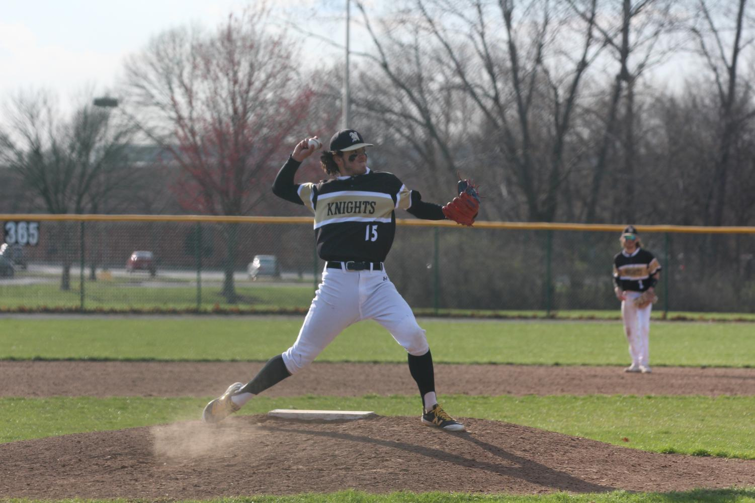 Sophomore Jackson Mitchell attempts to pick off a runner at first base during a game.