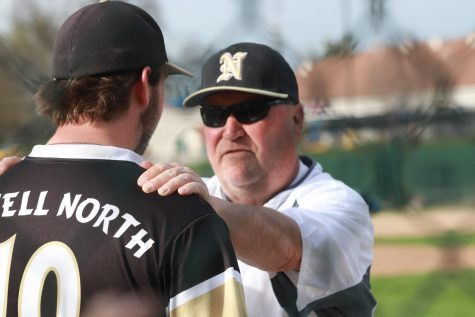 Head coach Bob Donahue talks to junior Adam Lange during game against Troy Buchanan.