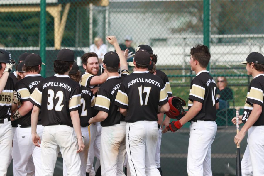 Varsity baseball team celebrates in game against Troy after a 2 run homer from senior Hunter Tabor.