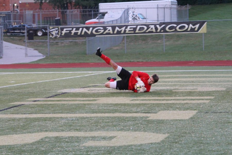 Senior Corey Valleroy makes a diving save, preventing a goal in a game against FHHS