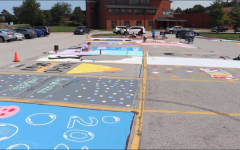 Seniors Paint New Reserved Parking Spaces