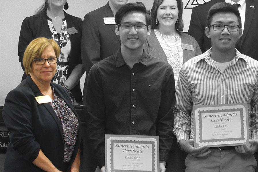 Hendricks-Harris presents an award to students last school year. (file photo)
