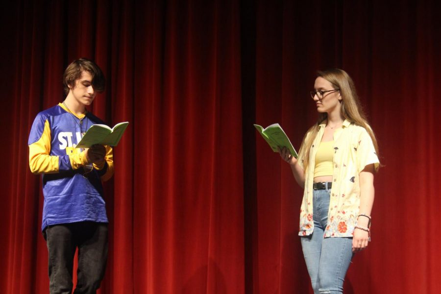 "Rehearsing their lines, junior Megan Miller and sophomore Bryce James practice for the upcoming play ""Lion and the Mouse Stories"". The play was preformed on Sept. 26, 27, and 28. The next two plays are set to happen in late November and early April. (Photo by Anna Hollinger)"