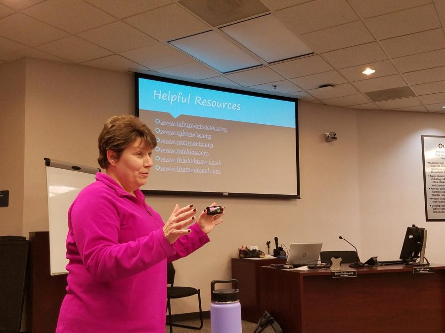 Prevention Education Specialist Karen Loesch teaches parents about resources they can use to monitor their child's online safety. (Photo by Chloe Horstman)