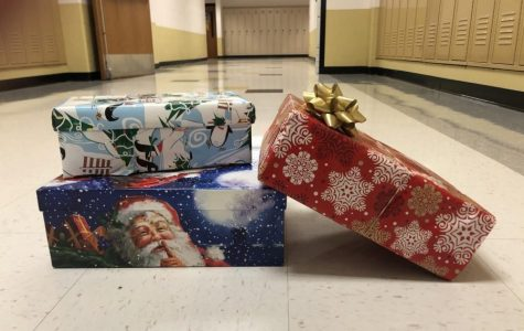 Junior and Senior NHS members work to collect holiday boxes for Samaritan's Purse. Students had the opportunity to put together a box consisting of clothes,  necessities and toys for families in need. (Photo by Allison Cavato)