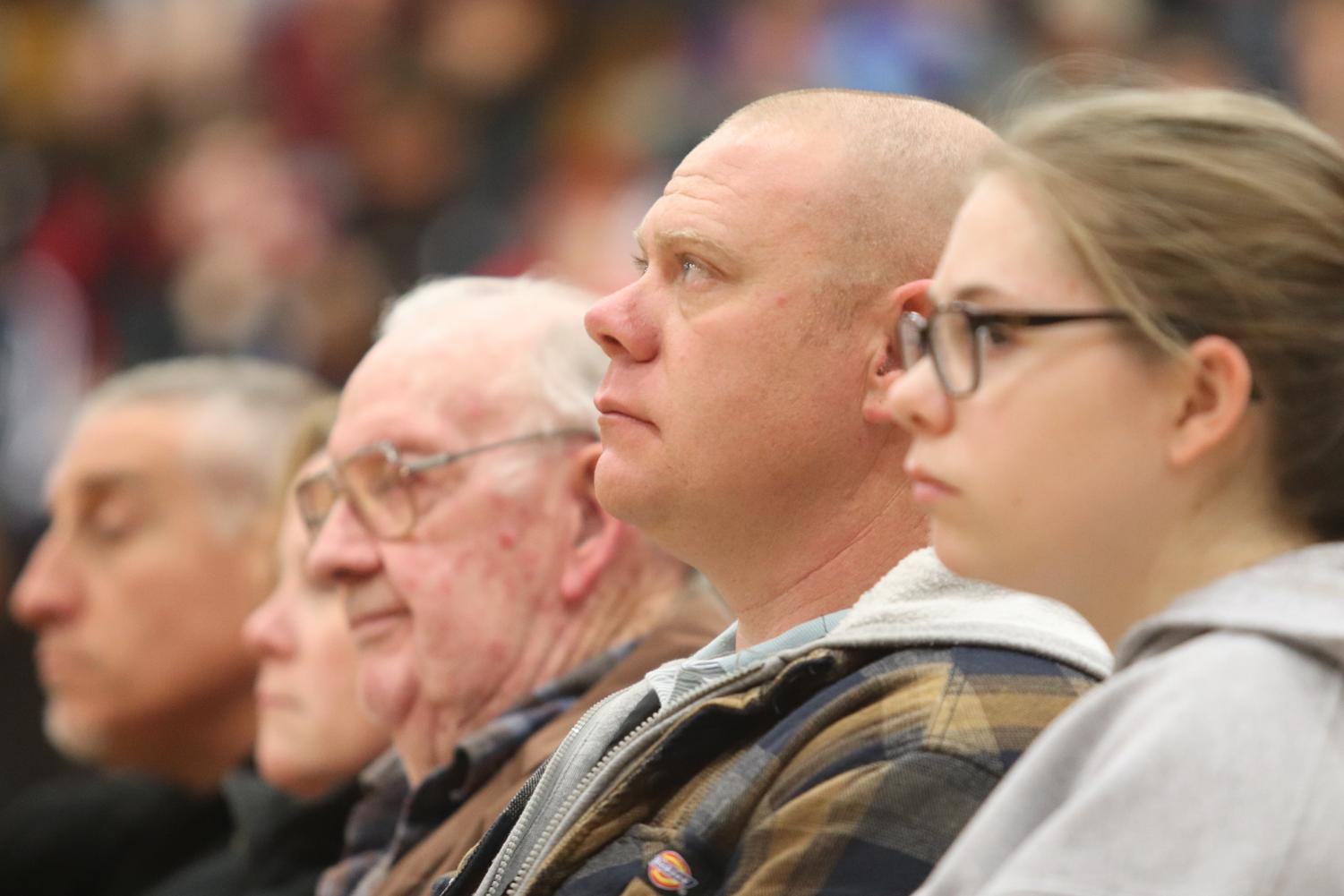Sergeant Corey Stutsman sits and watches during the Veterans day Assembly.