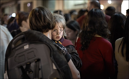 A child waits in line during a Harry Potter event.
