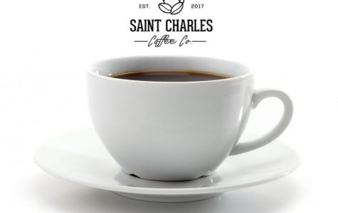 A cup of coffee sits on a plate with the logo of the new St. Charles Coffee Company above. The company was established in 2017 as a pop-up coffee shop in the St. Louis area and they pride themselves on donating profits to a charity of their choice. (Photo Illustration by Ella Manthey)