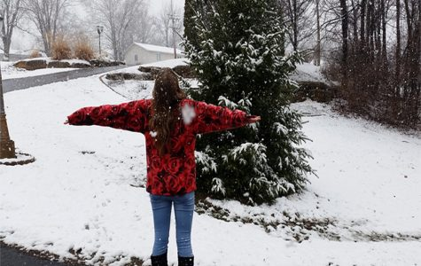 Junior Chloe Horstman spins in a snow flurry.  She feels snow is magical and timeless.