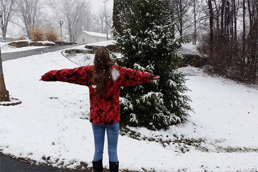 Junior+Chloe+Horstman+spins+in+a+snow+flurry.++She+feels+snow+is+magical+and+timeless.