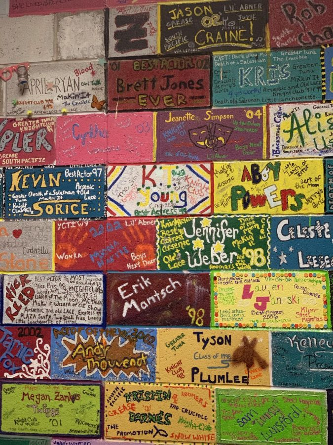 A wall of painted bricks sits directly next to the entrance to the scene shop. These are arguably the most memory-filled part of the scene shop, as they were painted by seniors as far back as the late 80s. Every senior who has since passed through the drama room has painted a brick, and the bricks extend all the way to the very back of the shop.