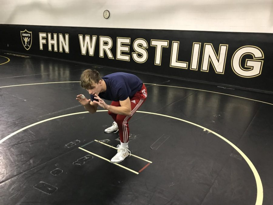 Senior Jeremiah Meter prepares for wrestling practice.