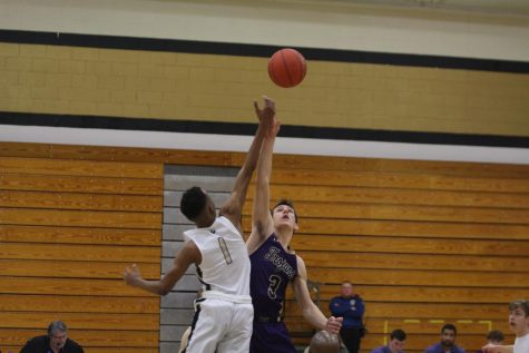 Boys Basketball Team Falls Late to Holt