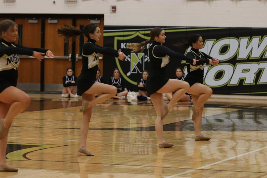 The varsity Knight line all spin in unison during the halftime performance.