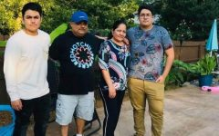 Jesus DeLaPaz [far left] stands with his Father and Mother [center] as well as his brother Julian [far right] during a visit with their family in Tennessee last summer.